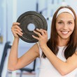 Young woman lifts weight - Stock Photo