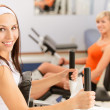 Two beautiful sportwomen make exercise — Stock Photo
