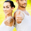 Man and woman lift upwards thumbs — Stock Photo