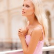 Woman in big hall at handrail — Stock Photo