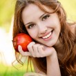 Girl with book and apple — Stock Photo