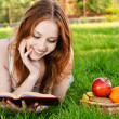 Girl with book and apples — Stock Photo