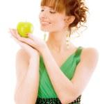 Smiling girl holds green apple — Stock Photo #3764980