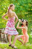 Girl photographer shoot model — Stock Photo