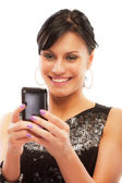 Charming girl reads sms on phone — Stock Photo