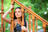 Sad young woman at handrail — Stockfoto