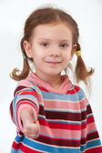 Little girl lifts forefingers upwards — Stock Photo