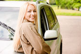 Driver-woman of car smiles — Stock Photo