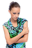 Woman in green dress reflects — Stock Photo