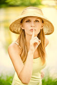 Girl in straw hat calls for silence — Stock Photo