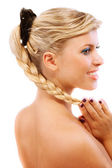 Beautiful blonde smiles, in profile — Stock Photo