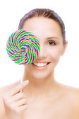 Lovely young woman with lolipop — Stock Photo
