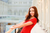 Brunette holds on to banister — Stock Photo