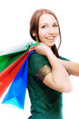 Young beautiful smiling woman with purchases — Stock Photo
