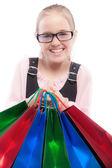 Small joyful girl with purchases — Stock Photo