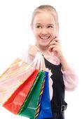 Jeune fille avec achats parle par téléphone — Photo
