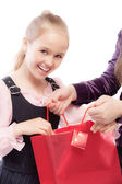 Young girl opens bag — Stock Photo