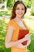 Long-haired girl with book — Stock Photo