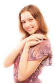 Charming girl in motley dress smiles — Stock Photo