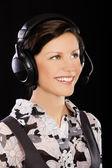 Girl in headset — Stock Photo