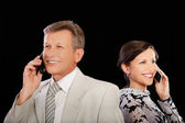 Businesspeople with cellphones — Stock Photo