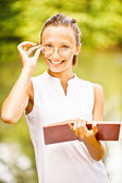 Girl-student with book — Stock Photo