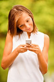 Portrait of beautiful girl with phone — Stock fotografie