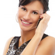 Beautiful brunette with cellphone — Stock Photo