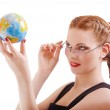 Red-haired girl with globe — Stock Photo