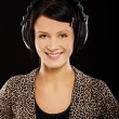 Girl in headphones - Stock Photo