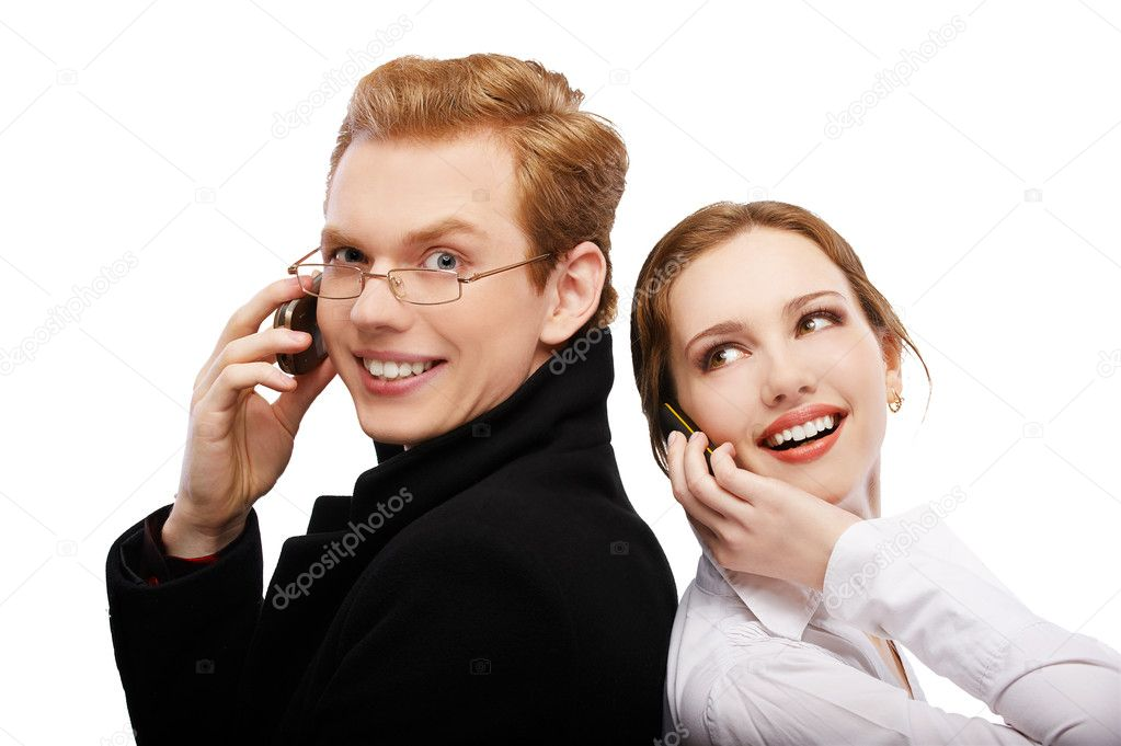 Portrait of happy red-haired couple with cellphones on white — Stock Photo #3866542