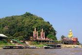 Statue of Buddha on river Mekong — Stock Photo