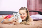 The girl with a cat — Stock Photo