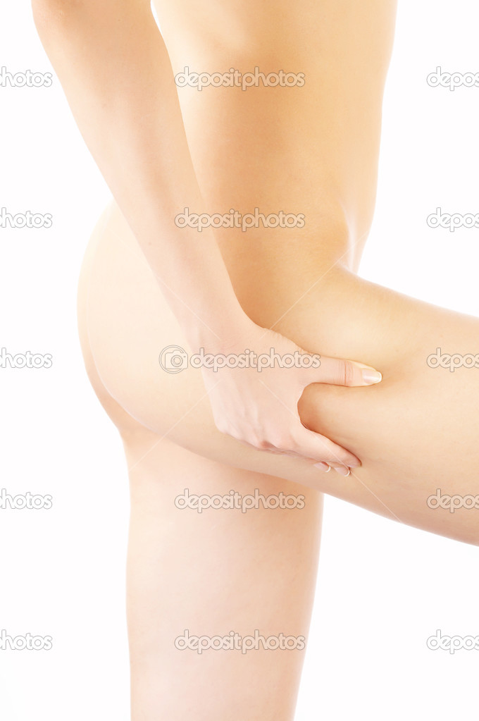 The hand compresses a skin fold on a hip — Stock Photo #2910162
