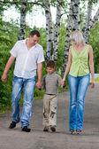 Happy family walking in the park — Stock Photo