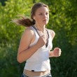 Young woman running outdoors — Stock Photo #3388386