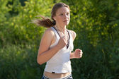 Young woman running outdoors — Stock Photo