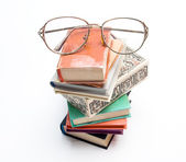 Glasses on a pile of books — Stock Photo