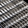 Punched metal on black close up - Stock Photo