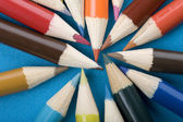 Crayon close up on blue background — Stock Photo