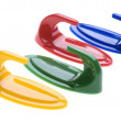 Colored plastic hook on white - Foto Stock