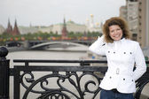 Russian woman and kremlin — Stock Photo