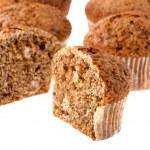 Cutting muffin on white — Stock Photo