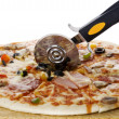 Pizza with knife close up on white — Stock Photo