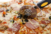Pizza with knife macro — Stock Photo