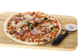 Pizza with knife on white — Stock Photo