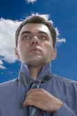 Men make tie on sky — Stock Photo