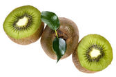 Cutting kiwi on white — Stock Photo