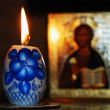 Candle and orthodoxy icon — Stock Photo