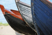 Three wooden boats on the shore — Stock Photo